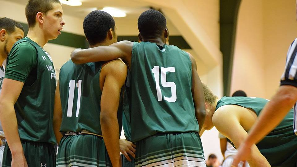 William Peace Mens basketball teammates comfort each other on the court
