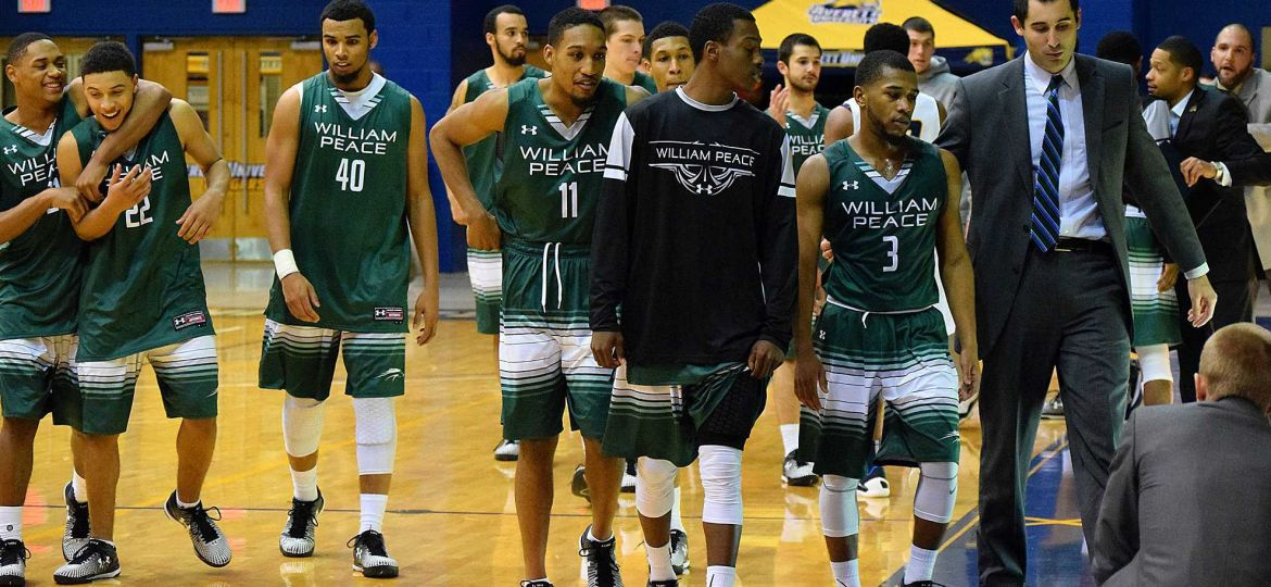 William Peace Mens basketball team walk off the courts
