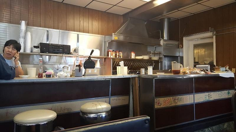 Interior of Finch's Diner; an old-timey bar with a visible grill
