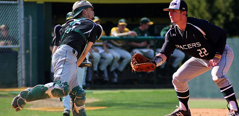 WPU baseball player ready at home plate to tag runner