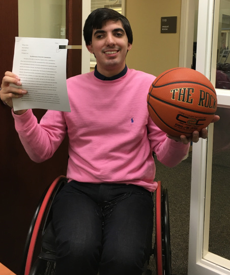 William Christy holding basketball and paper