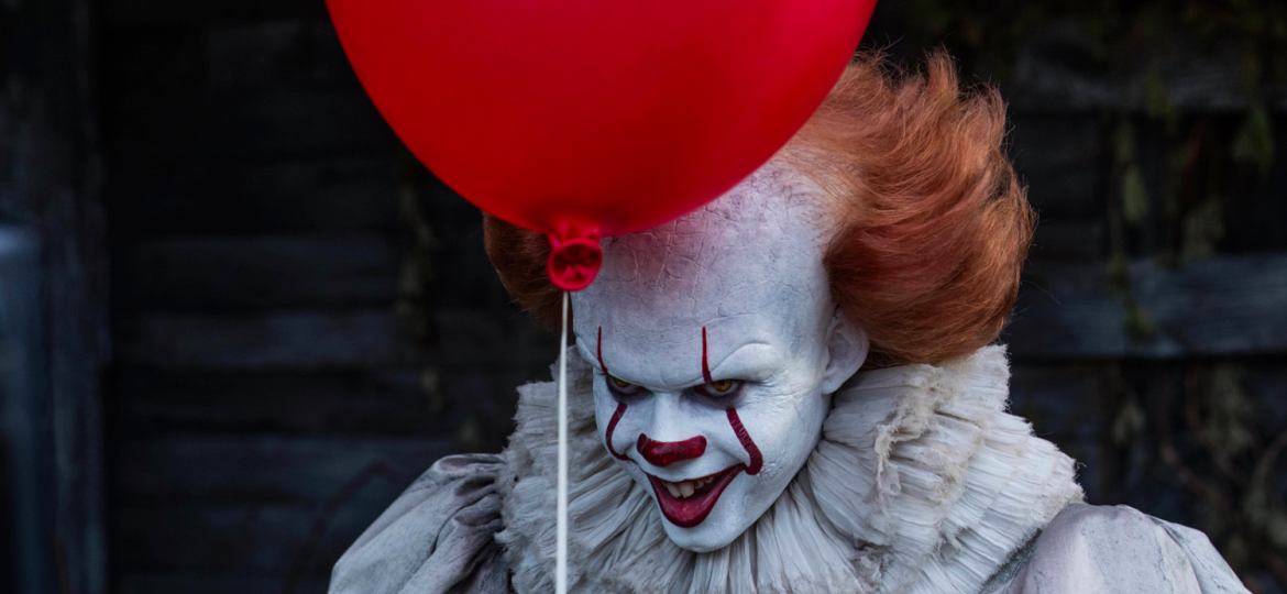 Pennywise the Clown holding a balloon while menacingly staring at the audience