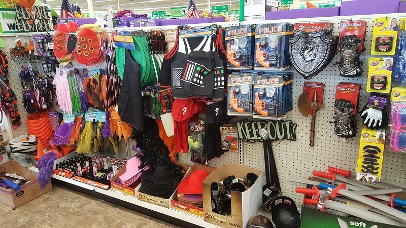rack of Halloween costumes