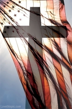 Cross and American Flag flying in the wind