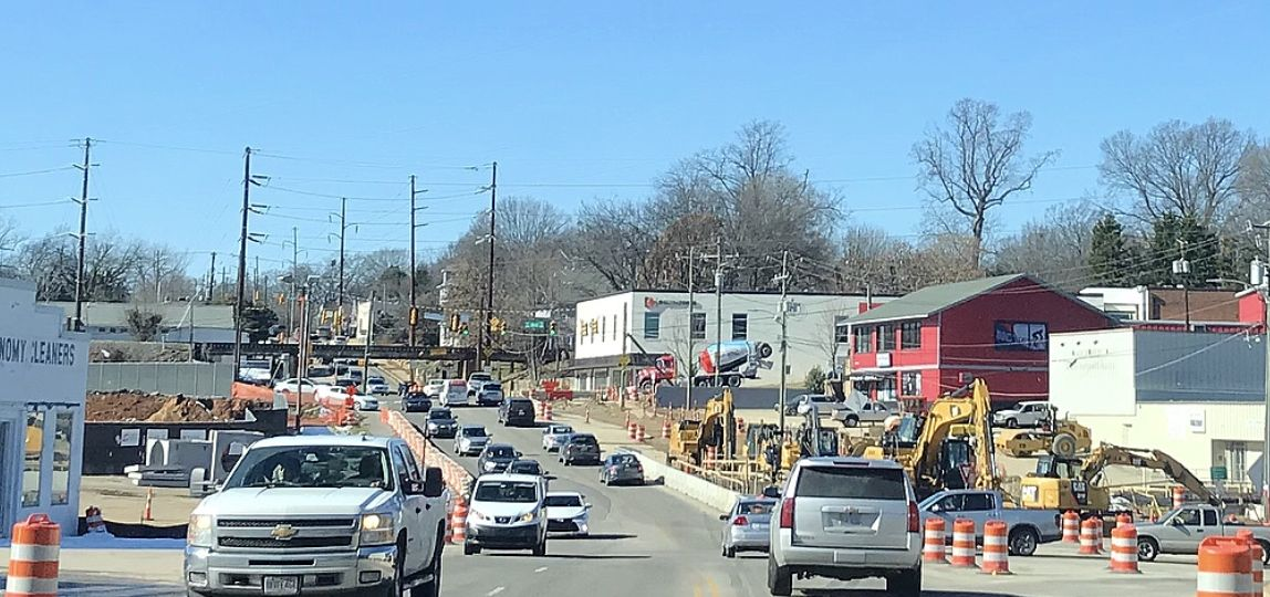 One lane of traffic in each direction along Peace Street