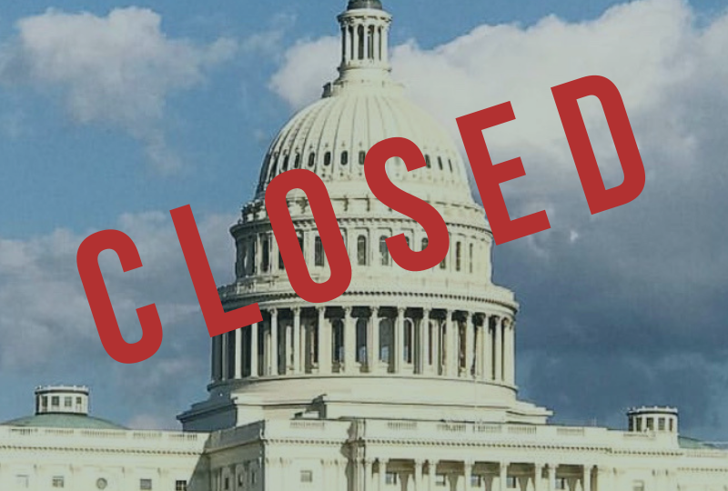 "The United States Capitol with the word ""closed"" over it"