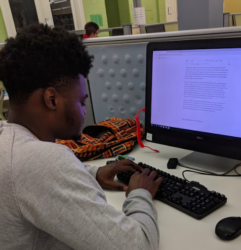 College student doing working on a computer