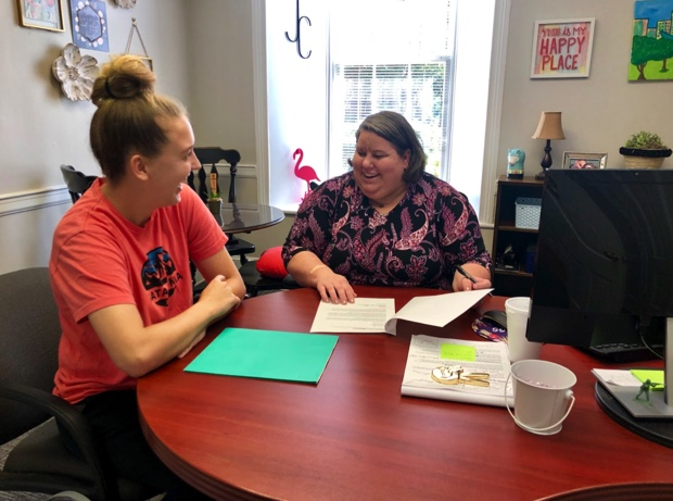 Assistant Director of the Career Design Center assisting a student through her future plans after graduation.